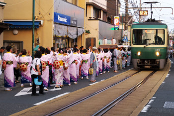 Local lady dancers giving way for a Enoden train sometimes during Yoimiya festival.