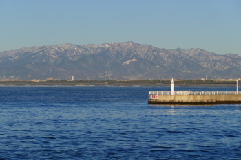 Snow-capped Tanzawa Mountains and port.