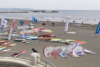 A event of wind surfing held at the beach.