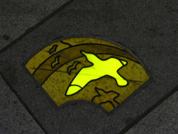 Yellow-green illuminated tile on Nakamise Street at night.