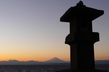 Old stone lantern and Mt.Fuji in the late afternoon sky.