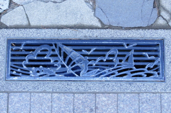 Gutter cover in Subana street is relief of wind surfing.
