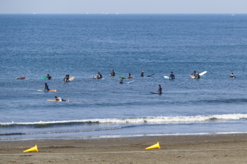 The beach is crowded with surfers almost everyday